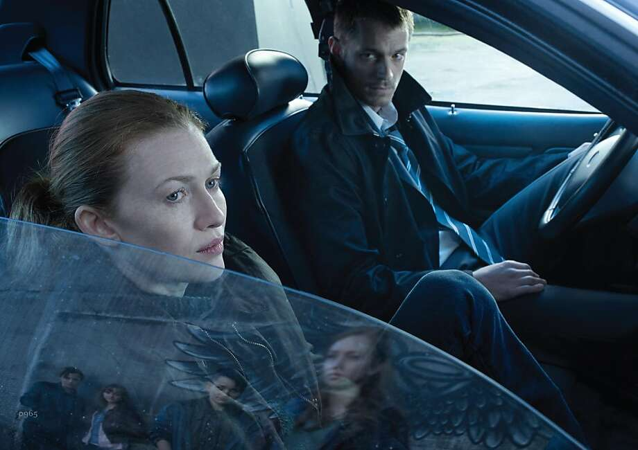 "Mireille Enos as Sarah Linden and Joel Kinnaman as Stephen Holder, the primary reasons to watch the first two seasons of ""The Killing,"" return for season three of the series that AMC had canceled and then decided to bring back. In the new story, Holder investigates a murder that is similar to one that former partner Linden had solved years ago. Photo: Frank Ockenfels, AMC"