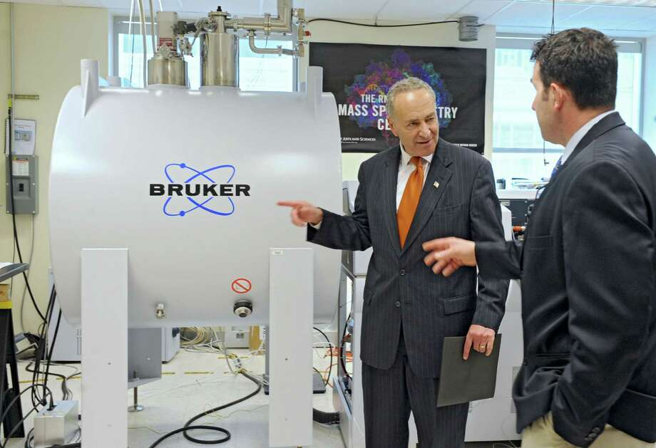U.S. Senator Charles Schumer, left, talks to UAlbany professor Dan Fabris, Ph.D., as he tours The RNA Institute at UAlbany Wednesday, May 29, 2013 at UAlbany in Albany, N.Y. U.S. Senator Charles Schumer announced his sponsorship of legislation that would funnel federal research dollars to top breast cancer research centers like The RNA Institute at UAlbany.  (Lori Van Buren / Times Union) Photo: Lori Van Buren / 00022608A