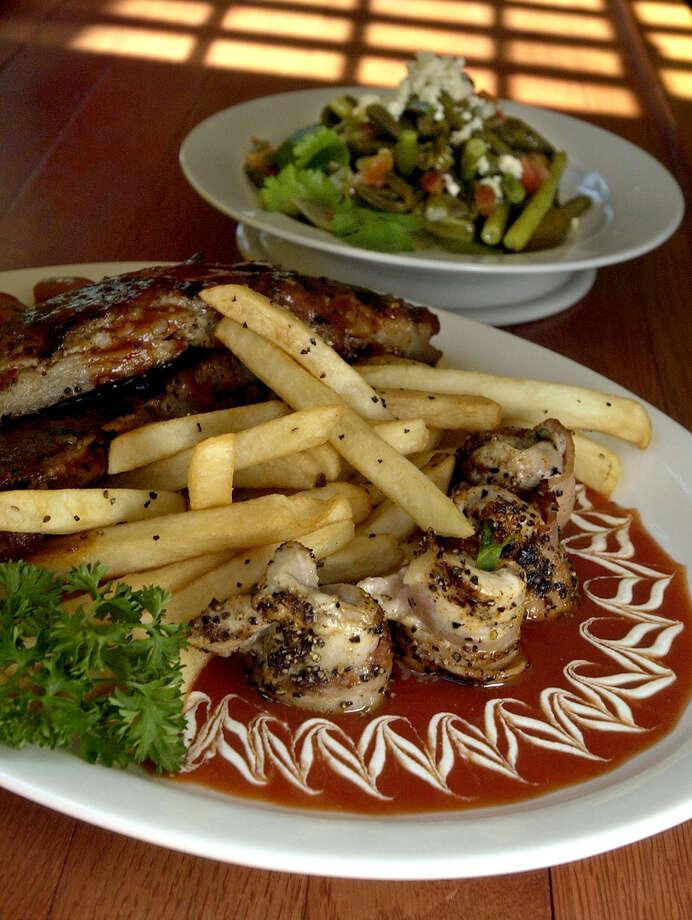 La Tuna Grill, 100 Probandt, shows off its La Tuna Grill plate. Photo: Express-News File Photo