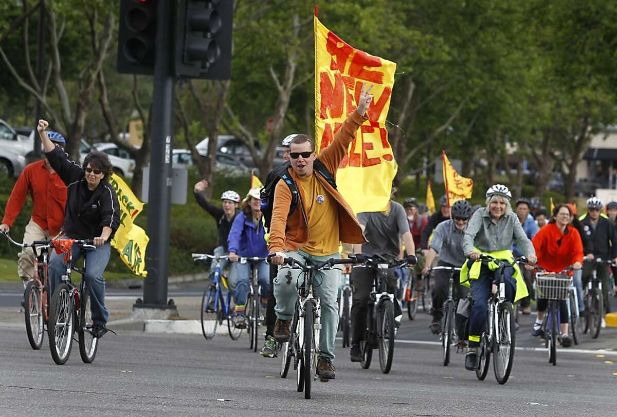 Demonstrators arrive at a protest outside of Chevron headquarters on bicycles in San Ramon, Calif. on Wednesday, May 29, 2013.