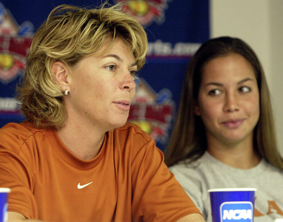 Texas pitcher Cat Osterman, right, looks on as head coach Connie Clark, left, answers a question at a news conference for the NCAA Women's College World Series in Oklahoma City, Wednesday, June 1, 2005. Texas faces Alabama in Game Four of the tournament on Thursday.  (AP Photo/Sue Ogrocki) Photo: SUE OGROCKI, STF / AP