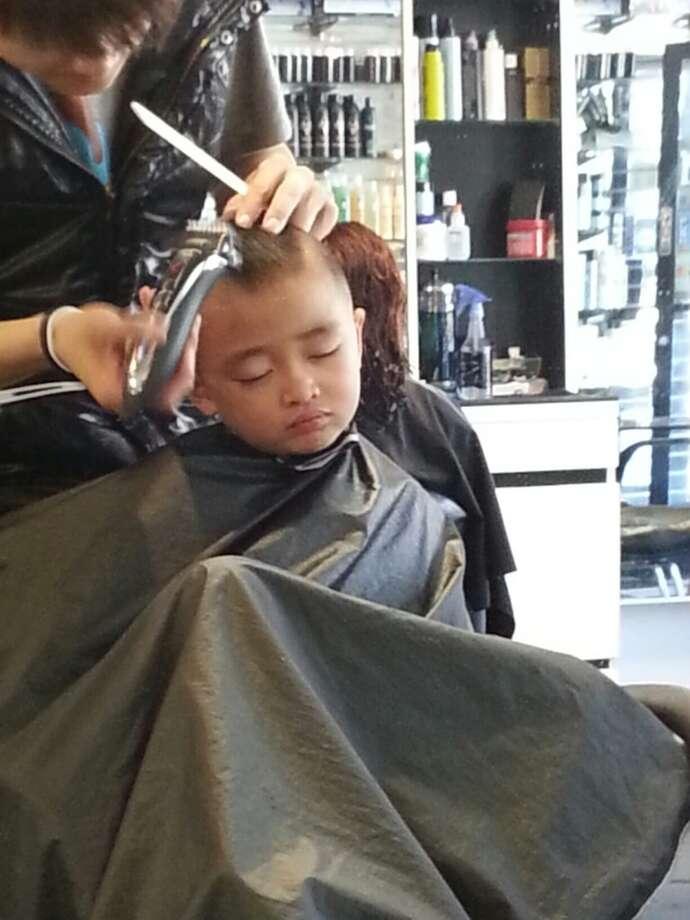 Asleep at the barbershop. Photo: Audrey Aguirre-Woo