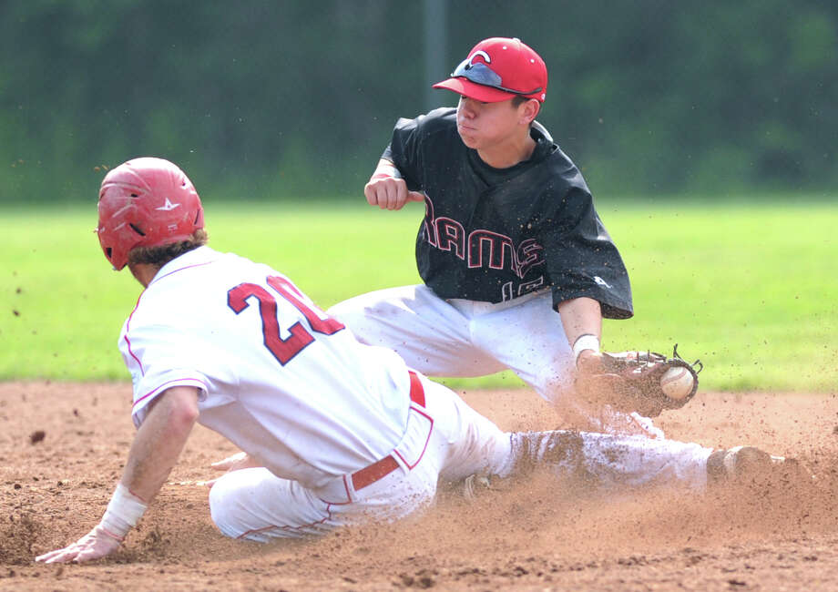At right, Cheshire's second baseman Tommy Savino takes the throw as Taylor Olmstead of Greenwich (# 20) safely steals second during the Class LL boys high school baseball playoff game between Greenwich High School and Cheshire High School at Greenwich, Wednesday, May 29, 2013. Greenwich defeated Cheshire, 9-2. Photo: Bob Luckey / Greenwich Time