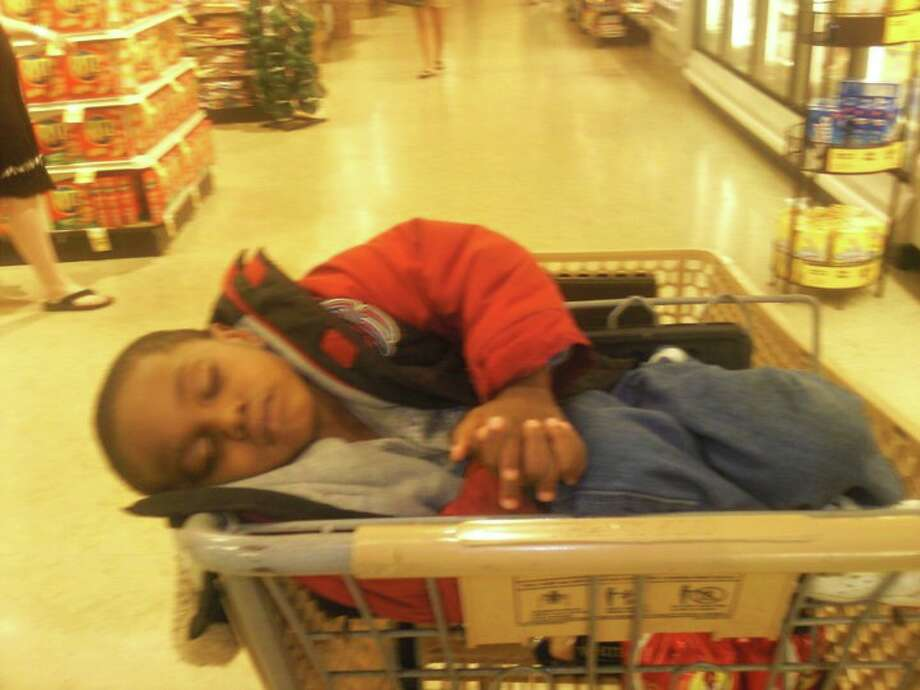 This little boy was told that if he behaved on a shopping trip with his aunt he'd get a treat. He was so quiet that he went right to sleep! Notice his folded hands! So sweet! Photo: Stephanie Tillery-Kemp