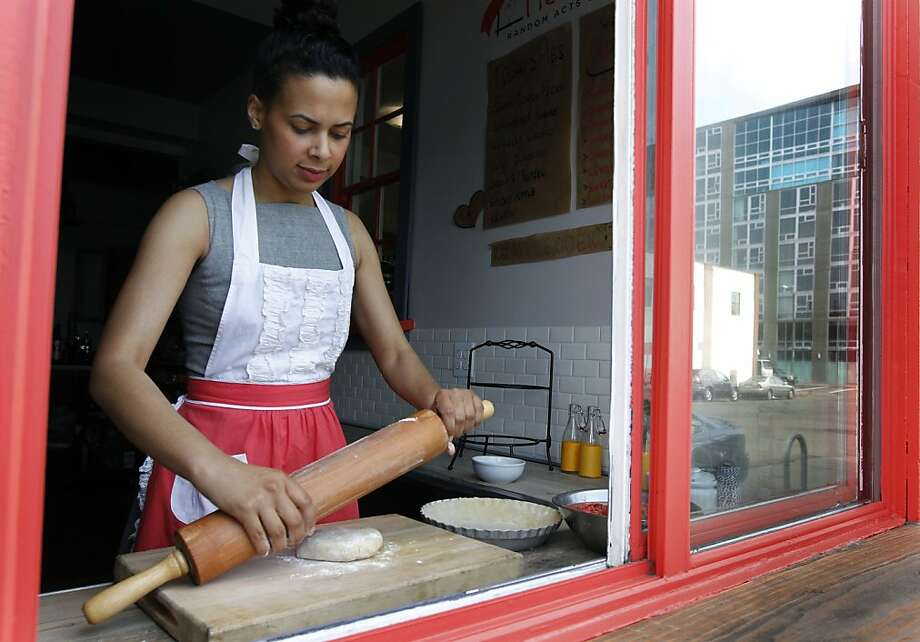 Jaynelle St. Jean begins rolling out the crust for a strawberry rhubarb pie behind the takeout window of her PieTisserie bakery in Oakland. Photo: Paul Chinn, The Chronicle