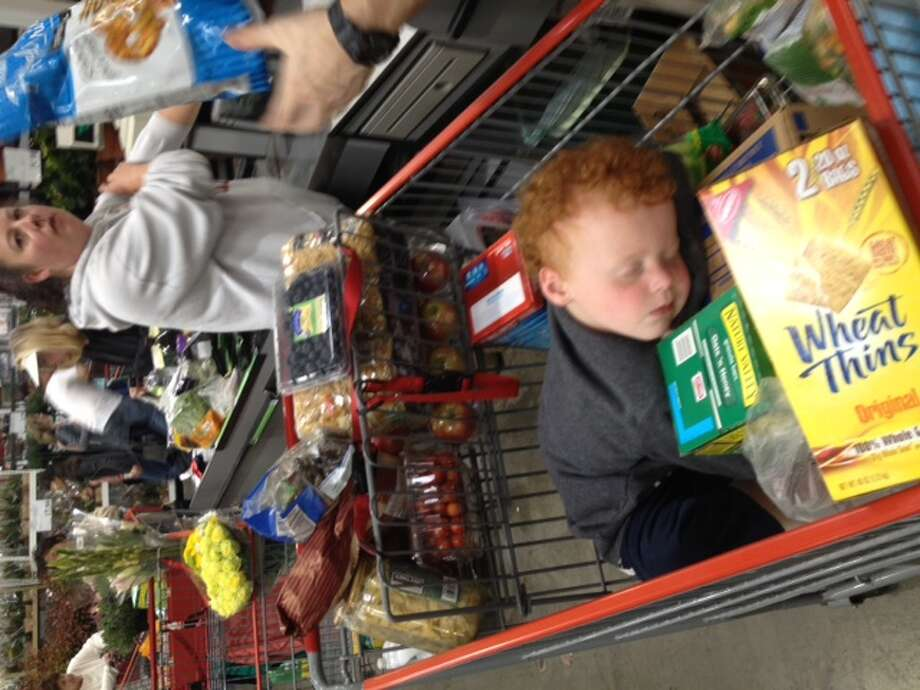 A box of milk makes a perfect pillow in a Costco shopping cart. Photo: Sally-dangelo