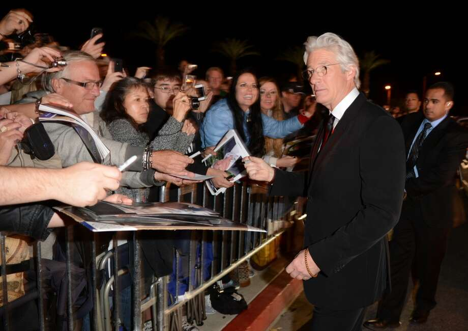 "Actor Richard Gere arrives at the 24th annual Palm Springs International Film Festival Awards Gala at the Palm Springs Convention Center in California on Jan. 5, 2013. The Avon Theatre in Stamford is set to welcome Gere on Tuesday, June 4, for a special screening of Terrence Malick's 1978 ""Days of Heaven."""