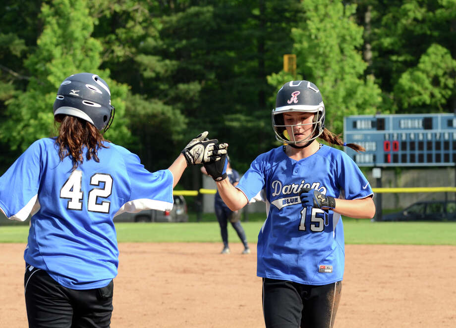 Darien's Emily Moscatello (42) bumps fists with teammate Avery Maley (15) during the 2013 CIAC Class LL Connecticut Girls State Softball Playoffs against Middletown High School at Darien High School on Wednesday, May 29, 2013. Photo: Amy Mortensen / Connecticut Post Freelance