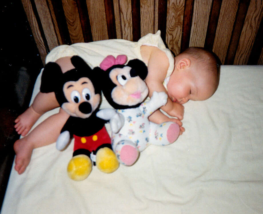 Snuggled up with Mickey and Minnie. Photo: Jack-mcgovern