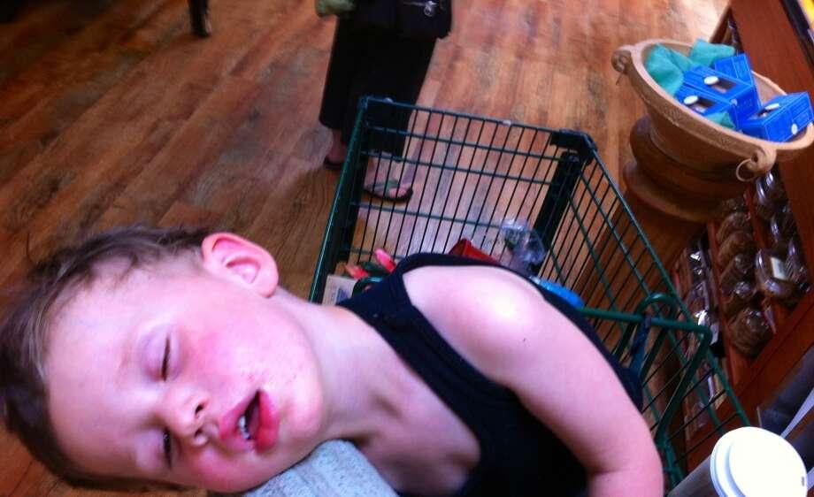 This boy nodded off in a shopping cart. Photo: Kelly-gavin