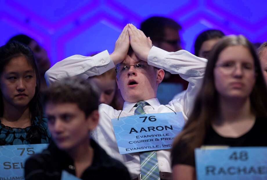 Aaron Michael Manning of Evansville, Ind., center, yawns while waiting for his turn during the third round of the National Spelling Bee on Wednesday, May 29, 2013. Photo: Evan Vucci, Associated Press / AP