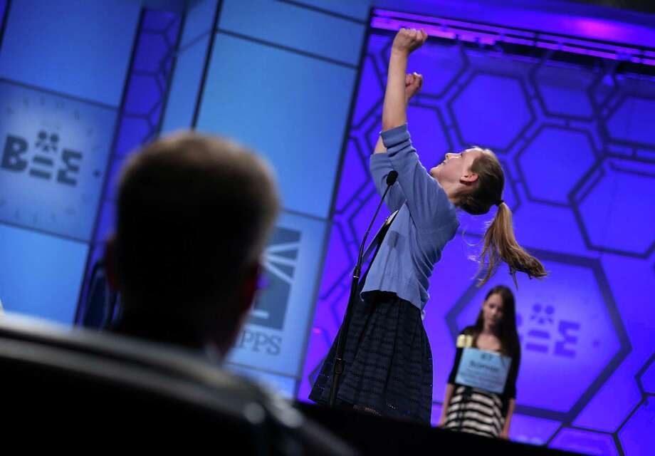 "Rebecca Lisk of Caledonia, Illinois, celebrates after she correctly spelled the word ""brankursine"" in round three of the 2013 Scripps National Spelling Bee May 29, 2013 at Gaylord National Resort and Convention Center in National Harbor, Maryland. Spellers competed in the annual spelling contest for the championship. Photo: Alex Wong, Getty Images / 2013 Getty Images"