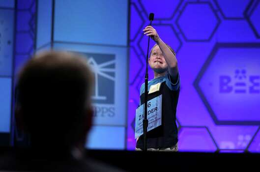 Zander Reed of Ankeny, Iowa, lower the microphone as he participates in the round three of the 2013 Scripps National Spelling Bee May 29, 2013 at Gaylord National Resort and Convention Center in National Harbor, Maryland. Spellers competed in the annual spelling contest for the championship. Photo: Alex Wong, Getty Images / 2013 Getty Images