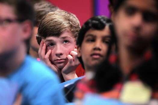 Lucas Michael Urbanski of Crystal Lake, Illinois, waits for his turn to spell in the second  round of the 2013 Scripps National Spelling Bee May 29, 2013 at Gaylord National Resort and Convention Center in National Harbor, Maryland. Two hundred and eighty spellers competed in the annual spelling contest for the championship. Photo: Alex Wong, Getty Images / 2013 Getty Images