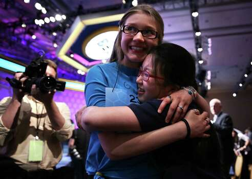 Katharine Wang (R) of Beijing, China, celebrates with Kate Miller (2nd R) of Abilene, Texas, after Wang found out she was advanced to semifinal the 2013 Scripps National Spelling Bee May 29, 2013 at Gaylord National Resort and Convention Center in National Harbor, Maryland. Spellers competed in the annual spelling contest for the championship. Photo: Alex Wong, Getty Images / 2013 Getty Images