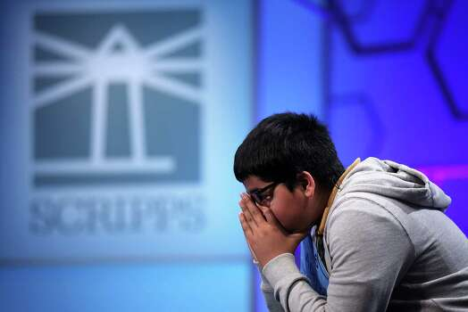 Aditya Mishra of Lincoln, California, waits for his turn to spell in the round three of the 2013 Scripps National Spelling Bee May 29, 2013 at Gaylord National Resort and Convention Center in National Harbor, Maryland. Spellers competed in the annual spelling contest for the championship. Photo: Alex Wong, Getty Images / 2013 Getty Images