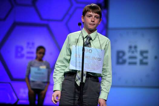 "Sterling Hollond of Linwood, Kansas, tries to spell a word in the round three of the 2013 Scripps National Spelling Bee May 29, 2013 at Gaylord National Resort and Convention Center in National Harbor, Maryland. Spellers competed in the annual spelling contest for the championship. Hollond misspelled the word ""febrility"" during the round and was eliminated from the competition. Photo: Alex Wong, Getty Images / 2013 Getty Images"