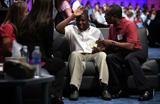 "Eboseremhen Eigbe of Galloway, New Jersey, is comforted by his father after he misspelled the word ""meiosis"" and was eliminated in the round three of the 2013 Scripps National Spelling Bee May 29, 2013 at Gaylord National Resort and Convention Center in National Harbor, Maryland. Spellers competed in the annual spelling contest for the championship. Photo: Alex Wong, Getty Images / 2013 Getty Images"