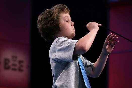 "Alexander Schembra of Lillington, North Carolina, lowers the microphone as he participates in round three of the 2013 Scripps National Spelling Bee May 29, 2013 at Gaylord National Resort and Convention Center in National Harbor, Maryland. Schembra misspelled the word ""Beethovenian"" during the round and was eliminated from the competition. Photo: Alex Wong, Getty Images / 2013 Getty Images"