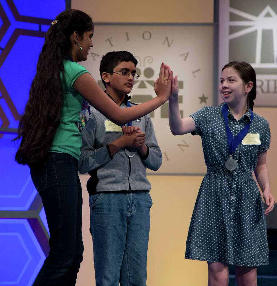 Grace Remmer, of St. Augustine, Fla., right, congratulates Himanvi Kopuri, of Denver, Colo., left, after it was announced that they both made the semifinal round of National Spelling Bee on Wednesday, May 29, 2013. Photo: Evan Vucci, Associated Press / AP