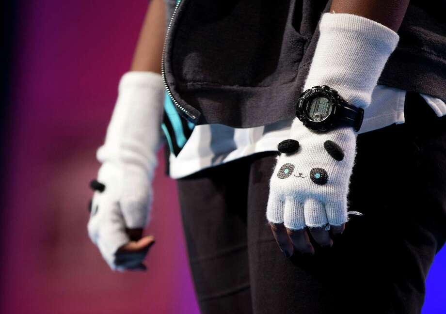 "Abirami Ratnakumar, of Seneca Falls, N.Y., wears panda bear gloves as she spells the word ""cyathiform"" correctly during the third round of the National Spelling Bee. Photo: Evan Vucci, Associated Press / AP"