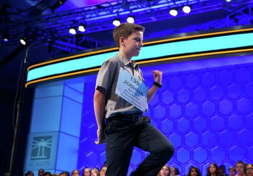 "Joshua Sturgill of Sedalia, Mo., pumps his fist after getting the word ""aggrandizement"" correct during the third round of the National Spelling Bee. Photo: Evan Vucci, Associated Press / AP"