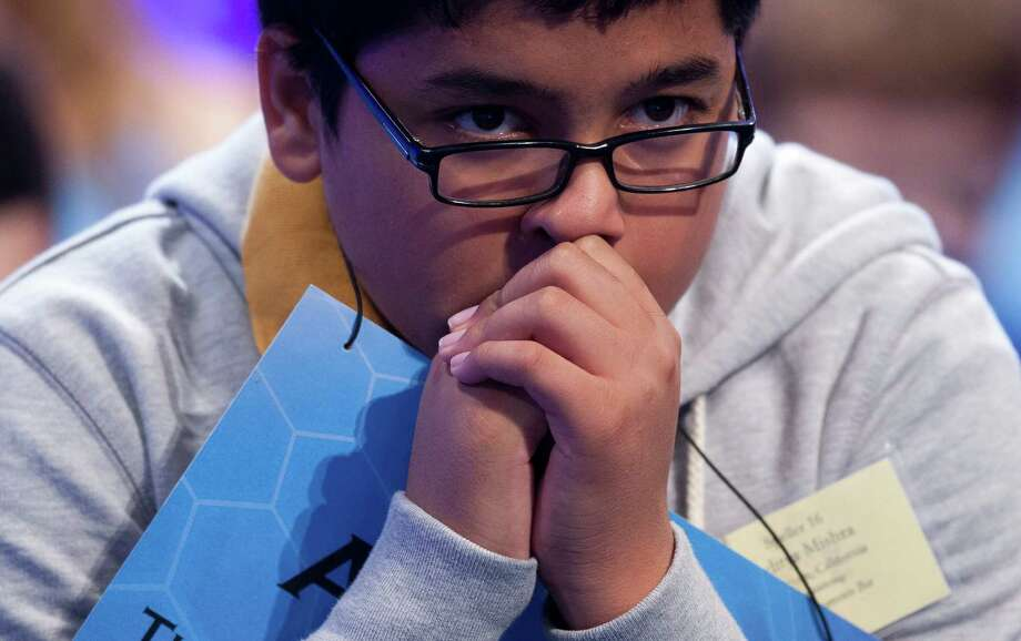 Aditya Mishra of Lincoln, Calif. waits for his turn during the third round of the National Spelling Bee. Photo: Evan Vucci, Associated Press / AP