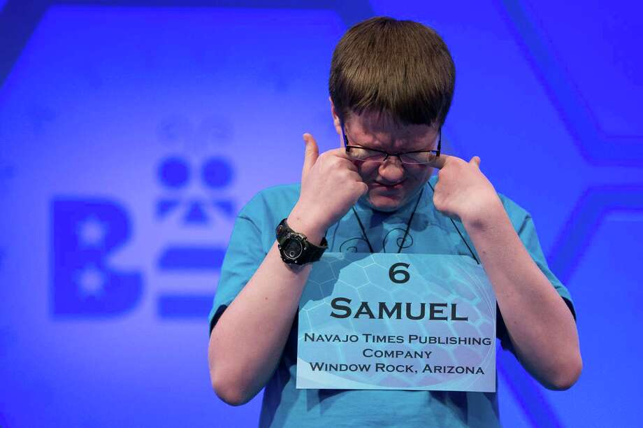 "Samuel Yeager, of Chinle, Ariz., wipes his eyes while waiting for his turn during the third round of the National Spelling Bee. Yeager spelled the word ""yannigan"" incorrectly. Photo: Evan Vucci, Associated Press / AP"