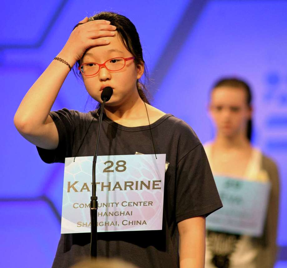 Katharine Wang, 11, of Beijing, China spells her word during the second round of the  Scripps National Spelling Bee. Photo: Cliff Owen, Associated Press / FR170079 AP