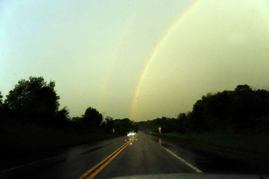 A rainbow intersects route 85 on Wednesday May 29, 2013 in Bethlehem, N.Y. (Michael P. Farrell/Times Union) Photo: Michael P. Farrell
