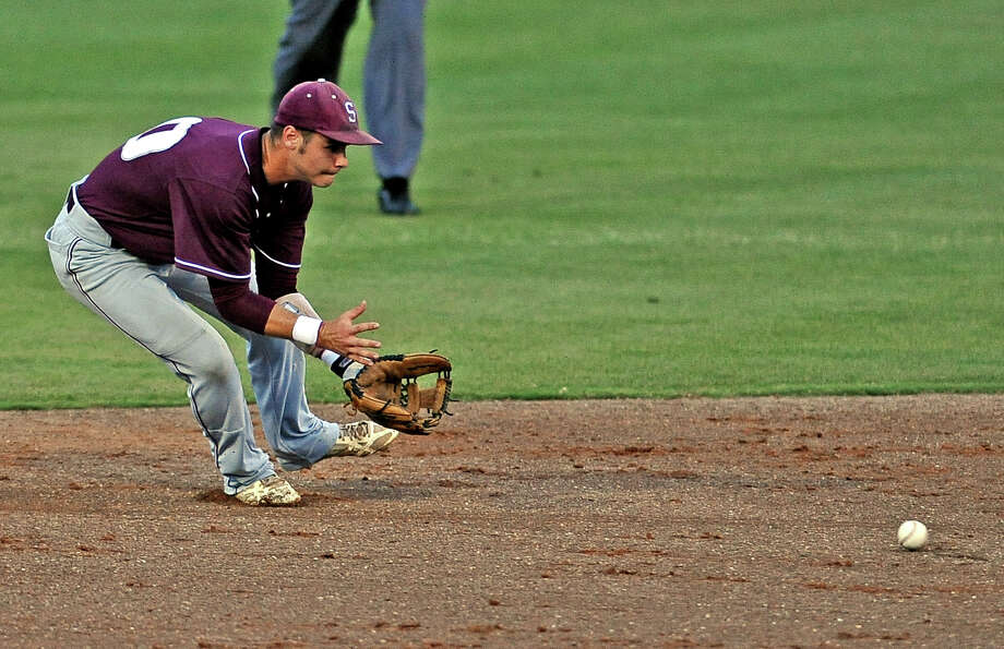 Silsbee shortstop Montana Garcia, #10, fields a ground ball during the Silsbee High School regional semi final baseball game against Carthage High School.  Silsbee won over Carthage 4 - 1. Photo taken: Randy Edwards/The Enterprise Photo: Randy Edwards