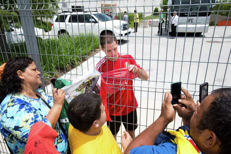 "Javier ""El Chicharito"" Hernandez is the object of affection after the Mexican national team finished a practice this week at BBVA Compass Stadium in preparation for Friday's match against Nigeria. Photo: Eric Kayne / 2013 Eric Kayne"