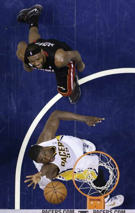 The Pacers' Roy Hibbert, at 7-foot-2, has proven difficult for LeBron James and the Heat to handle. He scored 23 points and grabbed 12 rebounds in Tuesday's Game 4 victory. Photo: Michael Conroy / Associated Press