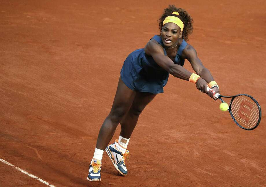 Serena Williams extends to return a shot to France's Caroline Garcia during Wednesday's match. Williams had little trouble beating the French wild-card entry 6-1, 6-2. Photo: Kenzo Tribouillard / AFP / Getty Images