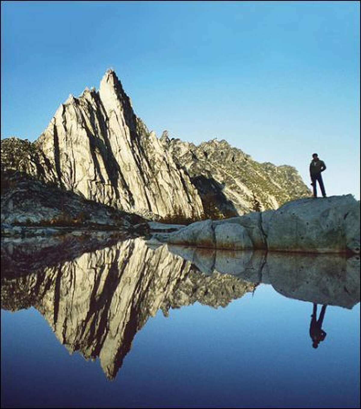 Surrounded by larch trees, with Prusik Peak as backdrop, Gnome Tarn in the Enchantment Lakes Basin of the Alpine Lakes Wilderness Area. Wilderness Area is one of Cascades' premier high elevation camp spots -- but not in a windstorm.  The U.S. Forest Service limits visitors from May 15 to October 31..(seattlepi.com file)