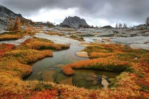 Storm clouds allow a glimpse of Prusik Peak during a hike in The Enchantment Lakes Basin of the Alpine Lakes Wilderness Area. (Joshua Trujillo, Seattle Post-Intelligencer file)
