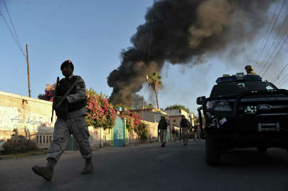 Security personnel patrol after a suicide bomb attack on a Red Cross office in Jalalabad. All seven Western employees working in the compound were evacuated. One was injured. Photo: Noorullah Shirzada / Getty Images