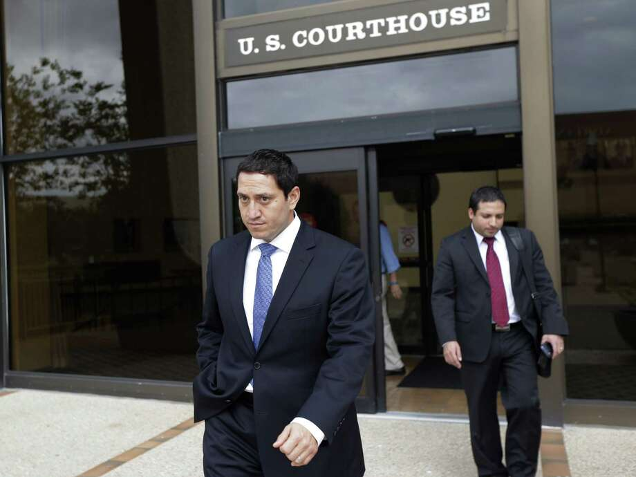 State Rep. Trey Martinez Fischer, D-San Antonio (foreground), leaves the federal courthouse following a hearing on the redistricting case in San Antonio. Judges pondered what impact a legislative special session will have on the issue. Photo: Eric Gay / Associated Press