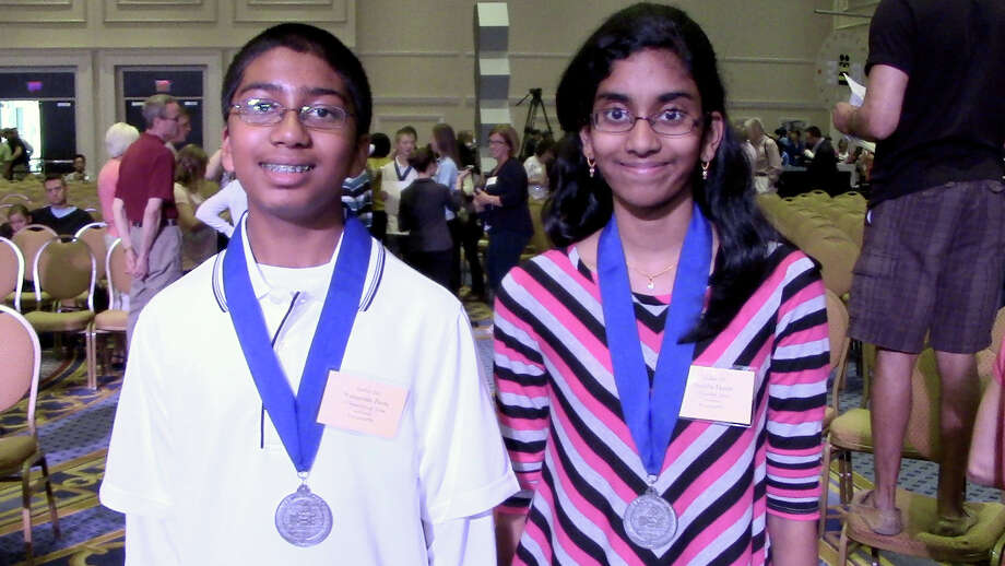 Two spellers from the Houston area — Friendswood seventh-grader Syamantak Payra, left, and Pearland sixth-grader Shobha Dasari — advanced to the semifinals of the 86th annual Scripps National Spelling Bee on Wednesday. Photo: Nicole Narea / for the Chronicle