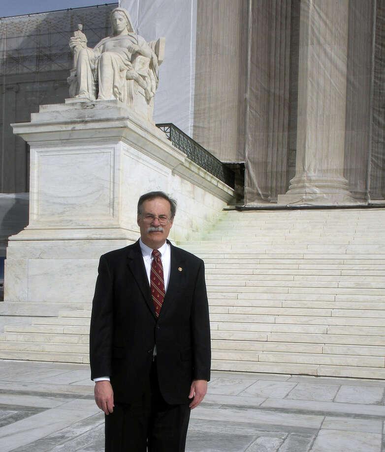San Antonio attorney Warren Wolf stands in front of the U.S. Supreme Court in Washington. Photo: Courtesy Photos