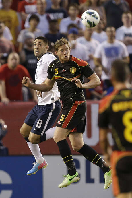 Nacogdoches' Clint Dempsey (left) and Belgium's Jan Vertonghen go up for a header in the first half. Photo: Tony Dejak / Associated Press