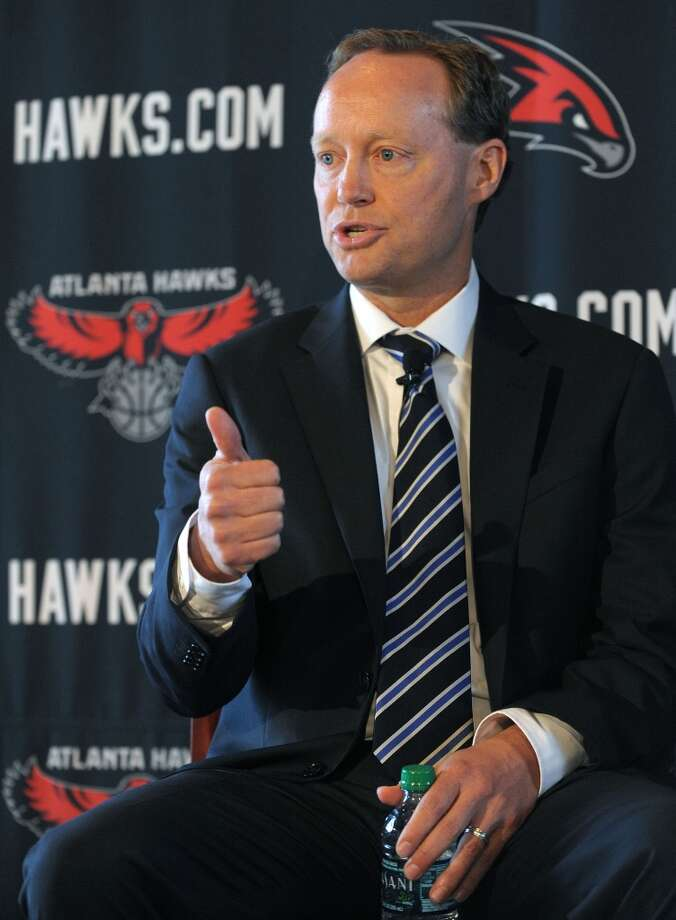 Atlanta Hawks' new NBA head coach Mike Budenholzer gestures as he speaks during a news conference Wednesday, May 29, 2013 in Atlanta. (AP Photo / David Tulis)