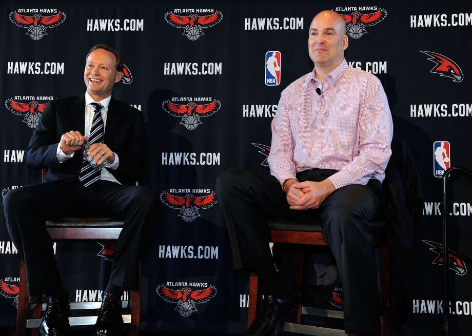 Atlanta Hawks President of Basketball Operations and General Manager Danny Ferry, right,  introduces new NBA head coach Mike Budenholzer during a news conference Wednesday, May 29, 2013 in Atlanta. (AP Photo / David Tulis)