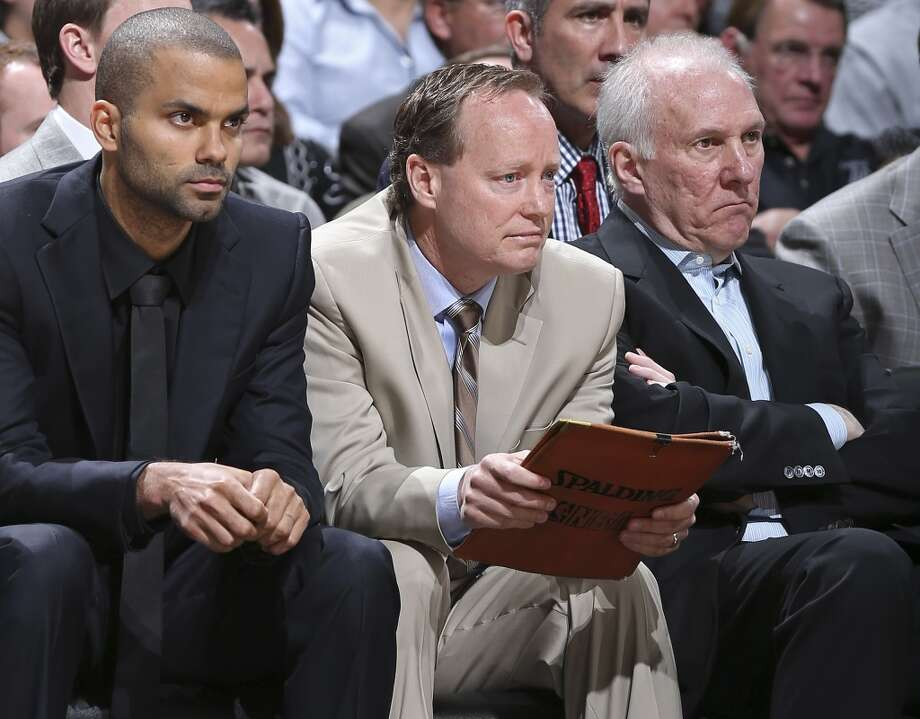 San Antonio Spurs' Tony Parker (from left), assistant coach Mike Budenholzer and head coach Gregg Popovich sit on the bench during first half action against the Oklahoma City Thunder Monday March 11, 2013 at the AT&T Center. (Edward A. Ornelas / San Antonio Express-News)
