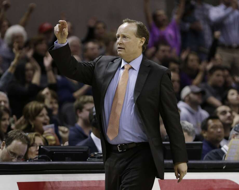 In the absence of head coach Gregg Popovich, San Antonio Spurs assistant coach Mike Budenholzer coaches the team during the fourth quarter of an NBA basketball game against the New Orleans Hornets, Wednesday, Jan. 23, 2013, in San Antonio. (AP Photo / Eric Gay)