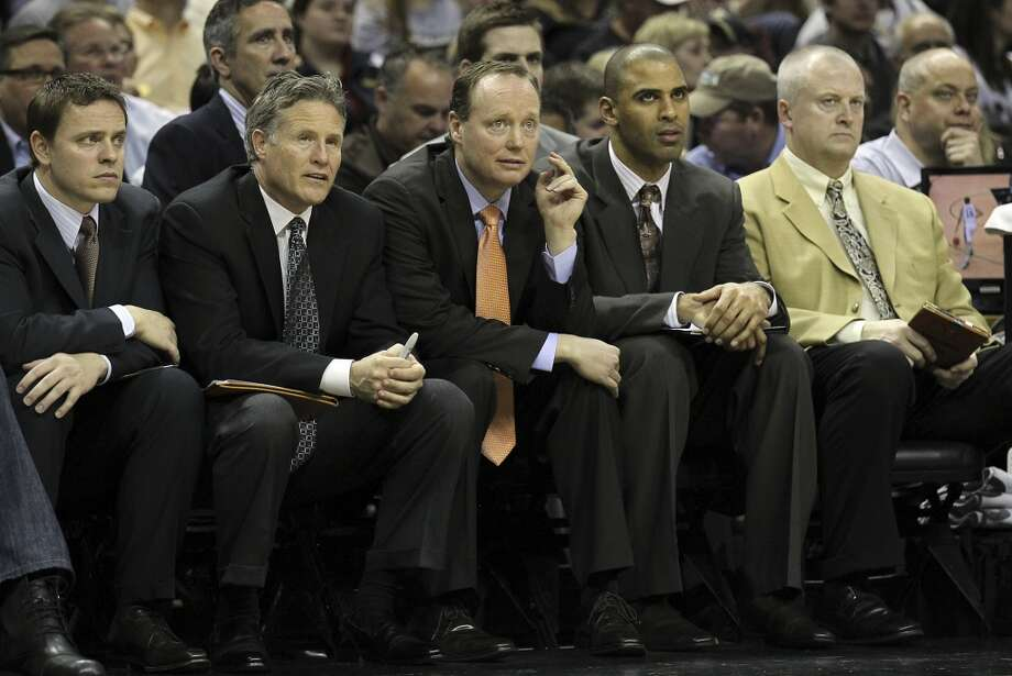 Spurs assistant coach Mike Budenholzer (center) takes the head coaching reigns against the New Orleans Hornets on Wednesday, Jan. 23, 2013. (Kin Man Hui / San Antonio Express-News)