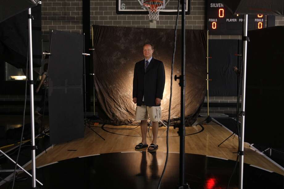 Spurs Assistant Coach Mike Budenholzer waits for his official team photo to be taking during have Media Day at their practice facility, Monday, Sept. 28, 2009. (Jerry Lara / San Antonio Express-News)