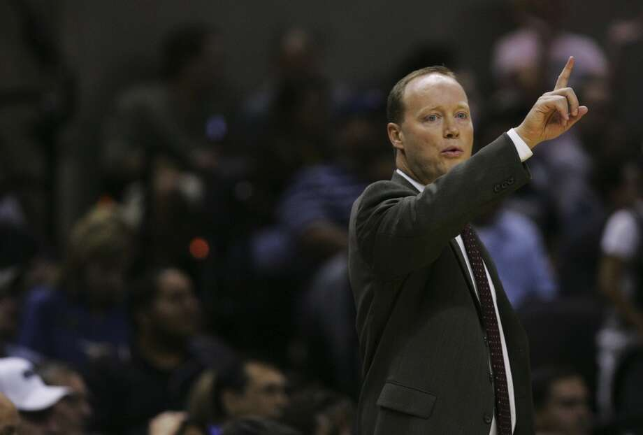 Spurs assistant coach Mike Budenholzer calls a play for the team as he assumes coaching responsibilities in the first half of their preseason game Thursday, October 18, 2007 at the AT&T Center. (San Antonio Express-News file photo)