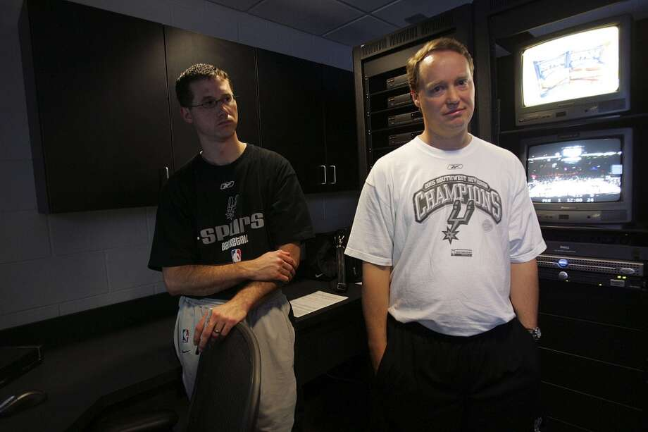 San Antonio Spurs Assistant Coach Budenholzer, right, and video coordinator Paul Rivers in the video room at the SBC Center on Sunday, June 12, 2005. (Jerry Lara / San Antonio Express-News)