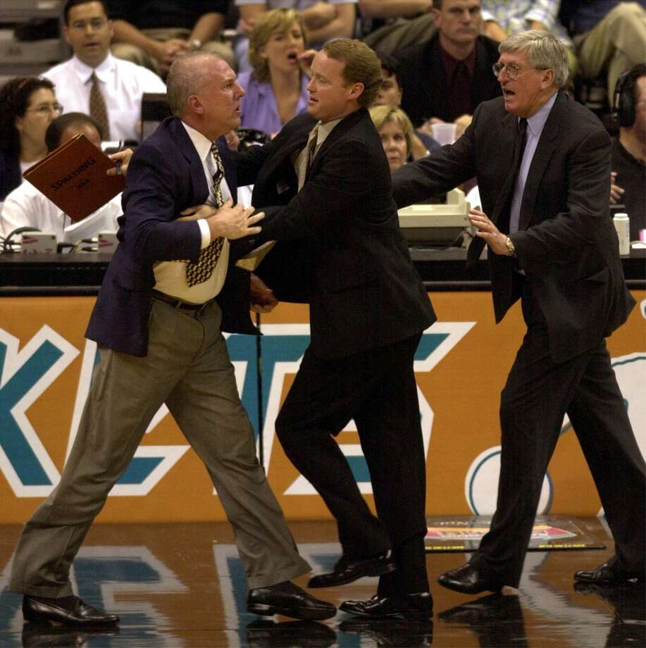 Spurs head coach Gregg Popovich is restrained by assistant coach Mike Budenholzer and Hank Egan after Popovich protested a flagrant foul call on Danny Ferry at the Alamodome on Monday, May 7, 2001. Popovich received a double technical and was ejected in the 2nd quarter. (Kin Man Hui / San Antonio Express-News)